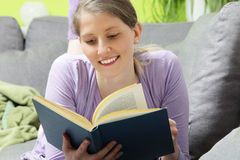 Woman relaxing reading a book Stock Image