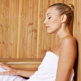 Attractive woman relaxing in sauna Stock Photos