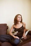Attractive woman relaxing on sofa Stock Image