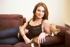 Attractive woman relaxing on sofa Royalty Free Stock Images