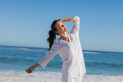 Attractive woman relaxing the sun Stock Photography