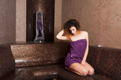 Attractive woman relaxing in turkish wet sauna Royalty Free Stock Image