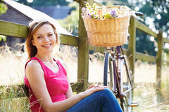 Attractive Woman Relaxing On Walk In Countryside Royalty Free Stock Images