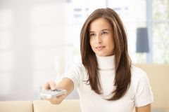 Attractive woman with remote control Stock Photo