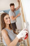Attractive woman renovating house smiling Stock Photography