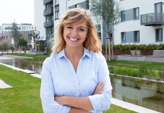 Attractive woman in a residential area Stock Photos