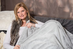 Attractive woman resting on a couch in the tent Stock Photo