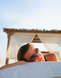 Attractive woman resting in the tropical beach Royalty Free Stock Photo