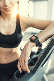 Attractive woman resting after workout on treadmill Stock Image