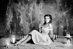 Attractive woman in retro, vintage, noir style. Black and white Royalty Free Stock Images
