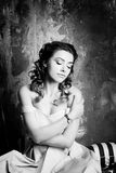 Attractive woman in retro, vintage, noir style. Black and white Stock Images