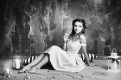 Attractive woman in retro, vintage, noir style. Black and white Royalty Free Stock Photo