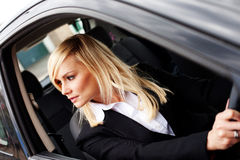Attractive woman reversing a car Royalty Free Stock Photos
