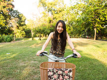 Attractive woman riding a bicycle Stock Photo