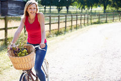 Attractive Woman Riding Bike Along Country Lane. In Daylight Smiling stock images