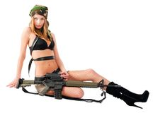 Attractive Woman with rifle. Beautiful sexy blond woman holding army rifle. Isolated on white Royalty Free Stock Images