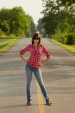 Attractive woman on roadway Royalty Free Stock Photo