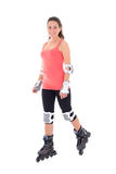 Attractive woman in roller skates isolated on white background Royalty Free Stock Photography
