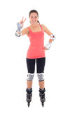 Attractive woman in roller skates posing isolated on white backg Royalty Free Stock Photo