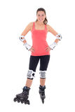 Attractive woman in roller skates posing on white background Royalty Free Stock Photo