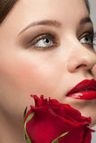 Attractive woman with rose Royalty Free Stock Photography