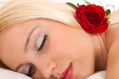 Attractive woman with rose Stock Photography