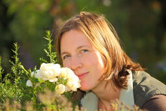 Attractive woman with roses Stock Photography