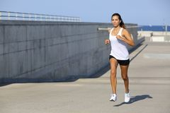 Attractive woman running on the asphalt Stock Photo