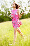 Attractive Woman Running Through field Stock Photo