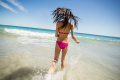 Attractive woman running in water Stock Photo