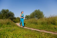 Attractive woman runs in the country Stock Image