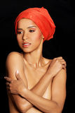 Attractive woman's bust in turban. Stock Image