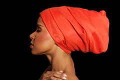 Attractive woman's profile in turban. Closed eyes. Isolated on black Royalty Free Stock Photography