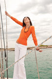 Attractive woman sailing on luxury yacht Stock Image