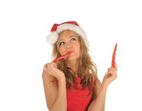 Attractive woman in Santa Cap with chili pepper Royalty Free Stock Images