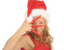 Attractive woman in Santa Cap with chili pepper Royalty Free Stock Photos