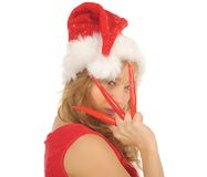 Attractive woman in Santa Cap with chili pepper Stock Photos