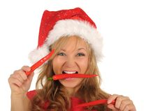 Attractive woman in Santa Cap with chili pepper Stock Photography