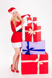 Attractive woman in santa claus dress posing with gift boxes Stock Image