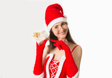 Attractive woman in Santa Clause costume holding Christmas gifts Royalty Free Stock Image