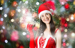 Attractive woman in Santa Clause costume holding Christmas gifts Stock Photography