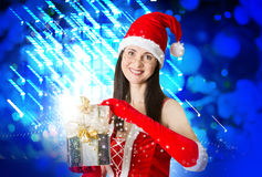 Attractive woman in Santa Clause costume holding Christmas gifts Stock Image
