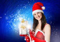 Attractive woman in Santa Clause costume holding Christmas gifts Royalty Free Stock Photography