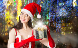 Attractive woman in Santa Clause costume holding Christmas gifts Stock Photos