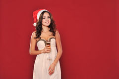 Attractive woman in santa hat with glass Stock Photo