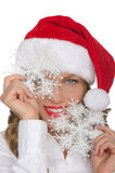 Attractive woman in Santa hat with snowflake Stock Images