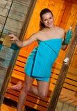 Attractive woman in sauna stock image