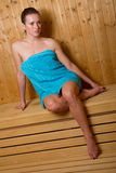Attractive woman in sauna Stock Image