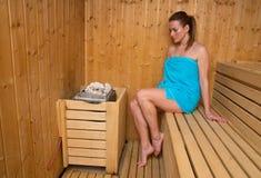 Attractive woman in sauna. Attractive woman sweating in sauna Stock Photo