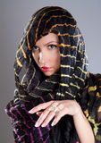 Attractive woman with scarf posing Royalty Free Stock Images
